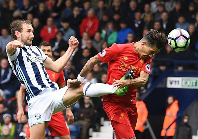 Liverpool's Roberto Firmino heads the opening goal past West Bromwich Albion's Craig Dawson during the English Premier League match at The Hawthorns in West Bromwich, central England, on April 16, 2017 (AFP Photo/Justin TALLIS)