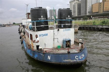 A ship loaded with refined fuel is anchored after it was seized from suspected pirates at a defence jetty in Lagos