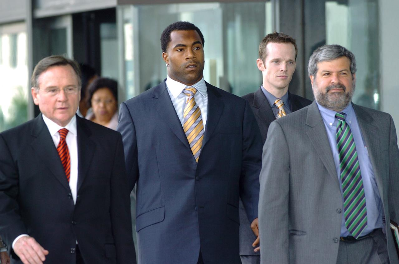 <p>The former Baltimore Ravens RB (middle) was given a four-month prison sentence in 2000 after pleading guilty to attempting to arrange a drug deal using his cell phone. </p>