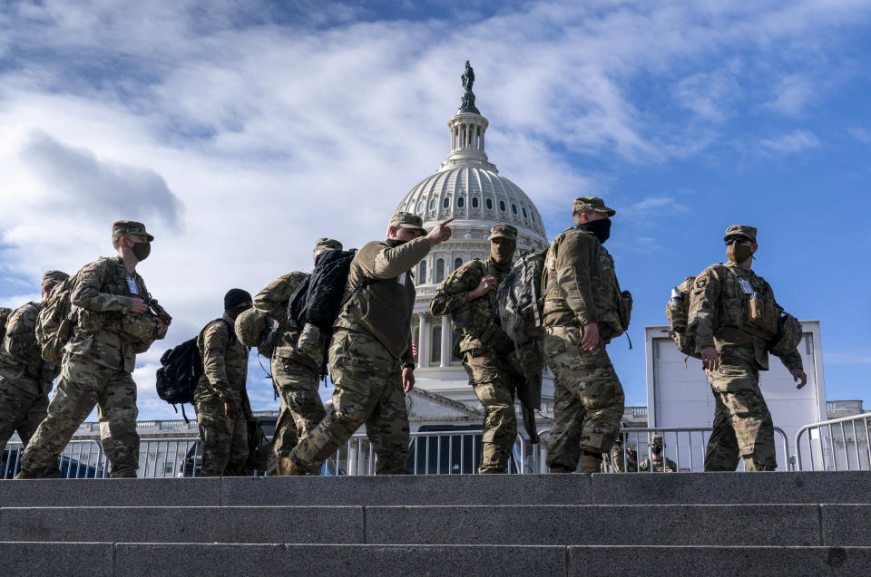 National Guard troops reinforce security around the U.S. Capitol ahead of the inauguration of President-elect Joe Biden and Vice President-elect Kamala Harris, Sunday, Jan. 17, 2021, in Washington. (AP Photo/J. Scott Applewhite)