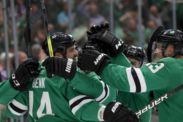 Dallas Stars left wing Jamie Benn (14), defenseman Esa Lindell, right, and the rest of the line celebrate a goal by Benn in the first period of an NHL hockey game against the Vancouver Canucks in Dallas, Tuesday, Nov. 19, 2019. (AP Photo/Tony Gutierrez)