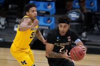 Florida State guard Anthony Polite (2) drives around Michigan guard Eli Brooks (55) during the second half of a Sweet 16 game in the NCAA men's college basketball tournament at Bankers Life Fieldhouse, Sunday, March 28, 2021, in Indianapolis. (AP Photo/Jeff Roberson)