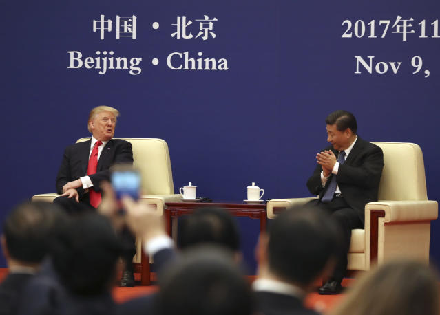 <p>U.S. President Donald Trump and Chinese President Xi Jinping attend a business event at the Great Hall of the People, Thursday, Nov. 9, 2017, in Beijing. Trump is on a five-country trip through Asia traveling to Japan, South Korea, China, Vietnam and the Philippines. (AP Photo/Andrew Harnik) </p>