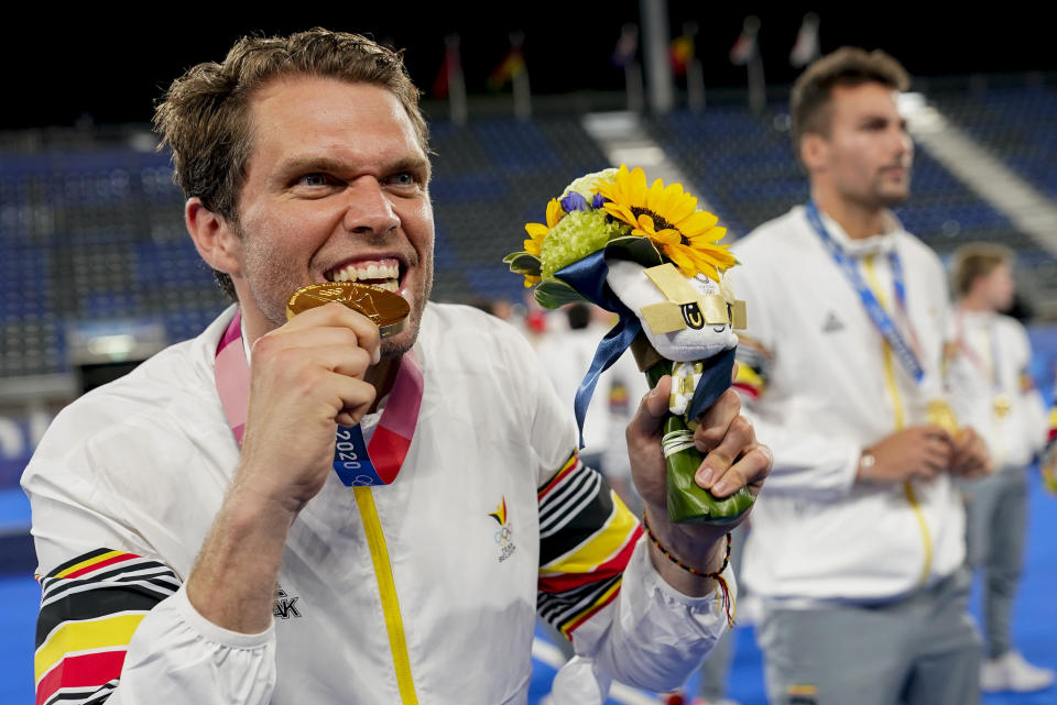 Belgium goalkeeper Vincent Vanasch (21) celebrates with his goal medal after Belgium defeated Australia in the men's gold medal field hockey match at the 2020 Summer Olympics, Thursday, Aug. 5, 2021, in Tokyo, Japan. (AP Photo/John Minchillo)