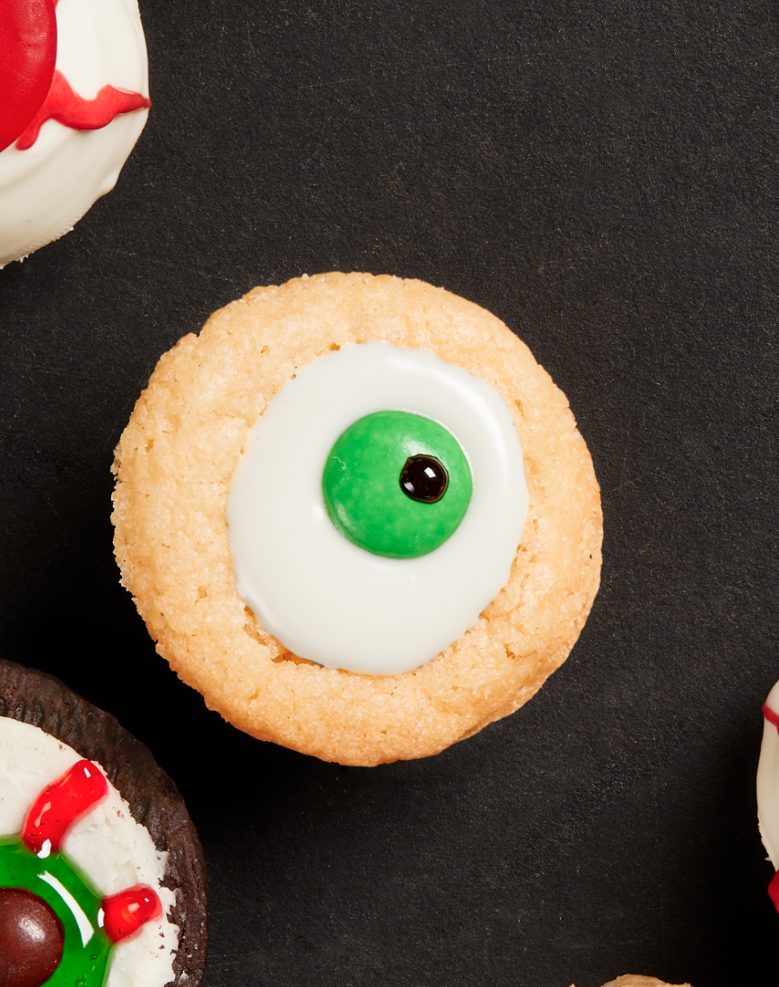 """<p>The key to these spooky """"eyeballs""""? A 24-cup mini muffin pan, which will help to create a small, decoration-friendly indentation in the center of each cookie.</p><p><strong><a href=""""https://thepioneerwoman.com/food-cooking/recipes/a32128998/sugar-cookie-eyeballs/"""" rel=""""nofollow noopener"""" target=""""_blank"""" data-ylk=""""slk:Get the recipe."""" class=""""link rapid-noclick-resp"""">Get the recipe.</a></strong></p><p><a class=""""link rapid-noclick-resp"""" href=""""https://go.redirectingat.com?id=74968X1596630&url=https%3A%2F%2Fwww.walmart.com%2Fip%2FThe-Pioneer-Woman-Spring-10-Piece-Baking-Prep-Set-Teal%2F269954471&sref=https%3A%2F%2Fwww.thepioneerwoman.com%2Ffood-cooking%2Fmeals-menus%2Fg32110899%2Fbest-halloween-desserts%2F"""" rel=""""nofollow noopener"""" target=""""_blank"""" data-ylk=""""slk:SHOP BAKING TOOLS"""">SHOP BAKING TOOLS</a></p>"""