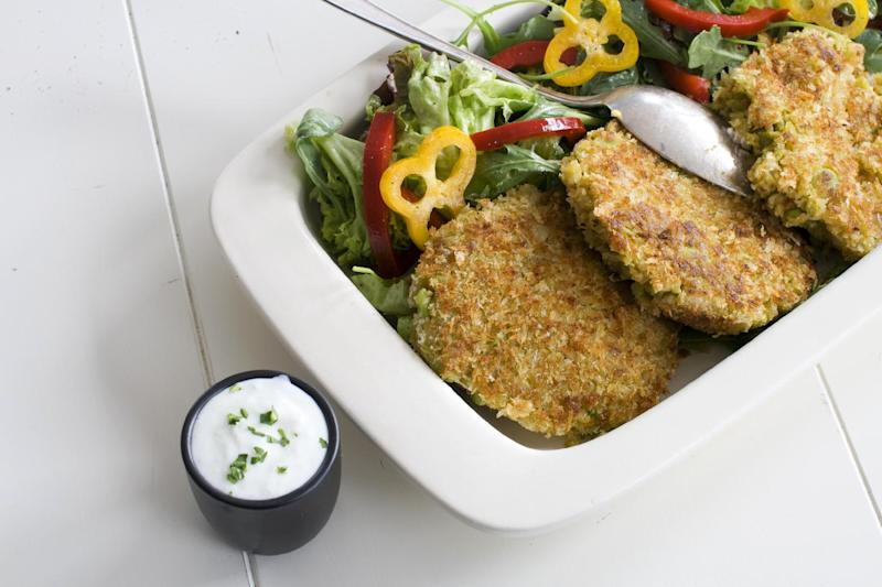 This March 25, 2013 photo taken in Concord, N.H., shows a recipe for Fava Bean Falafel Burger topped with a cucumber yogurt sauce. Falafel are deep-fried fritters made from ground chickpeas or fava beans. (AP Photo/Matthew Mead)