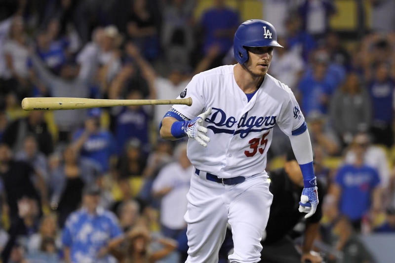 FILE - In this Sept. 18, 2019, file photo, Los Angeles Dodgers' Cody Bellinger tosses his bat as he runs to first after hitting a solo home run during the eighth inning of the team's baseball game against the Tampa Bay Rays in Los Angeles. the National League MVP figures to come down Christian Yelich of the Brewers and Bellinger, with Anthony Rendon of the Nationals possibly in the mix as well. (AP Photo/Mark J. Terrill, File)