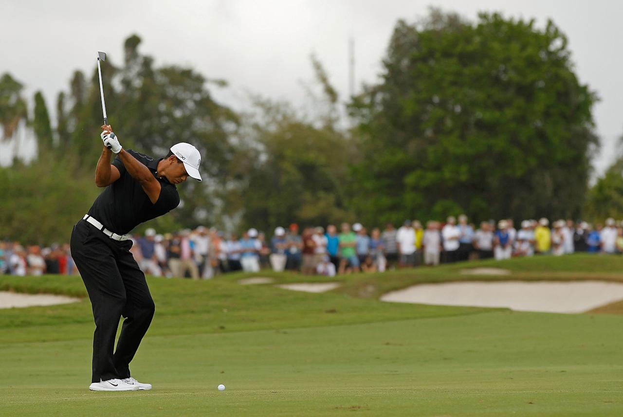 MIAMI, FL - MARCH 08:  Tiger Woods hits his approach shot on the fifth hole during the first round of the 2012 World Golf Championships Cadillac Championship at Doral Golf Resort And Spa on March 8, 2012 in Miami, Florida.  (Photo by Mike Ehrmann/Getty Images)