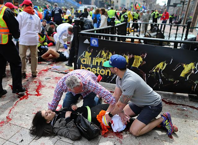 <p> ADDS NAME OF VICTIM - FILE - In this April 15, 2013 file photo, Sydney Corcoran, of Lowell, Mass. is tended to at the finish line of the Boston Marathon after two bombs exploded, in Boston. As people lay badly bleeding in the smoke of the Boston Marathon bombings, rescuers immediately turned to a millennia-old medical device to save their lives _ the tourniquet. Using belts, shirts and other materials, they tied off bleeding limbs in fast-acting bids to prevent major blood loss, shock and death. Such fast work no doubt saved many lives, doctors at Boston area hospitals said. (AP Photo/The Boston Globe, John Tlumacki) MANDATORY CREDIT, BOSTON HERALD OUT, QUINCY OUT, MAGS OUT, NO SALES.</p>
