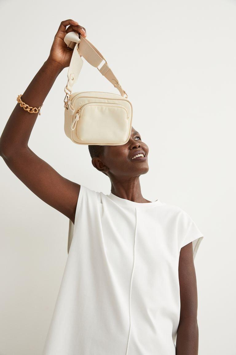 <p>This <span>H&amp;M Nylon Shoulder Bag</span> ($25) is lightweight and so easy to style. This is also a great bag to throw in your suitcase for a trip.</p>