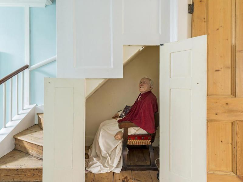 A life-size wax figure of Pope Jean Paul II can be found under the stairs (Kinleigh, Folkard & Hayward)