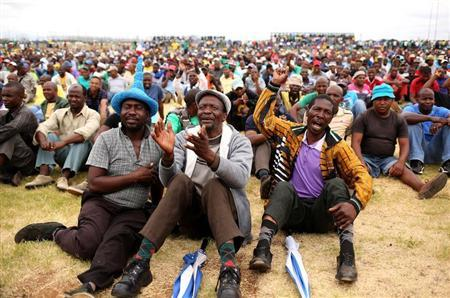 Miners gather at Wonderkop stadium outside the Lonmin mine in Rustenburg, northwest of Johannesburg