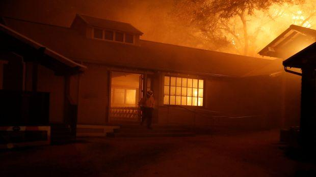 Photo of a burning building due to the dangerous Kincade wildfire in northern California