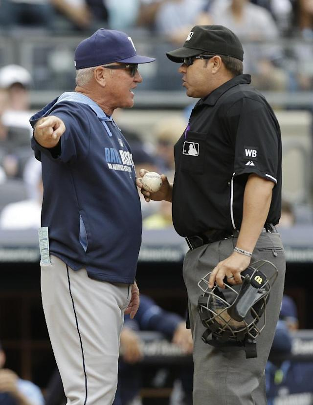 Tampa Bay Rays manager Joe Maddon argues a call with home plate umpire Doug Eddings during the fifth inning of a baseball game against the New York Yankees Saturday, May 3, 2014, in New York. (AP Photo/Frank Franklin II)