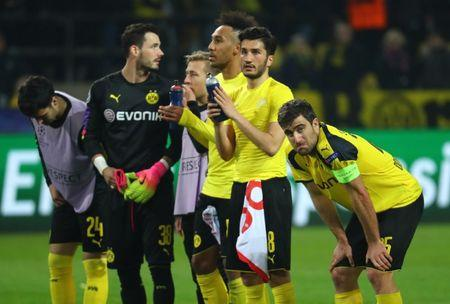 Football Soccer - Borussia Dortmund v AS Monaco - UEFA Champions League Quarter Final First Leg - Signal Iduna Park, Dortmund, Germany - 12/4/17 Borussia Dortmund players applaud fans as Sokratis Papastathopoulos (R) looks dejected at full time Reuters / Kai Pfaffenbach Livepic