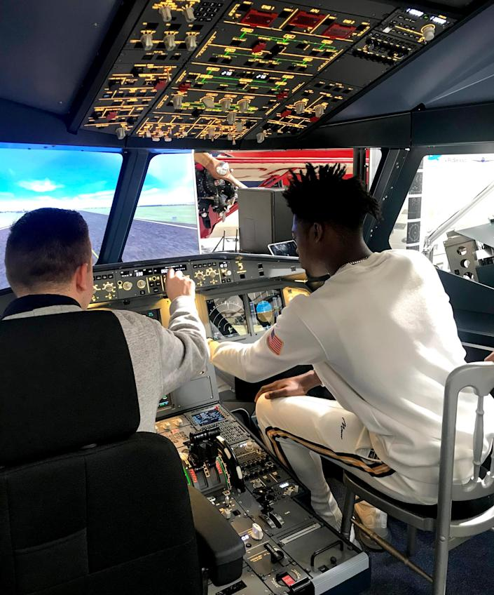 Wesley Appiah sits in an Airbus A320 cockpit. An aspiring pilot, he streams flights on Microsoft Flight Simulator. (Courtesy Wesley Appiah)