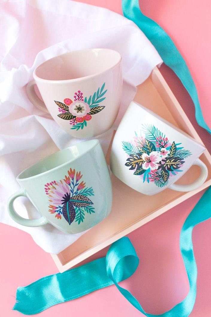 """<p>Who knew you could create gorgeous floral mugs using temporary tattoos? Your mom will think of you every time she takes a sip.</p><p><strong>G</strong><strong>et the tutorial at <a href=""""https://sarahhearts.com/diy-floral-temporary-tattoo-mugs/"""" rel=""""nofollow noopener"""" target=""""_blank"""" data-ylk=""""slk:Sarah Hearts"""" class=""""link rapid-noclick-resp"""">Sarah Hearts</a>.</strong></p><p><strong><a class=""""link rapid-noclick-resp"""" href=""""https://go.redirectingat.com?id=74968X1596630&url=https%3A%2F%2Fwww.walmart.com%2Fbrowse%2Farts-crafts-sewing%2Fcraft-storage%2F1334134_6355365_1285843&sref=https%3A%2F%2Fwww.thepioneerwoman.com%2Fholidays-celebrations%2Fgifts%2Fg32307619%2Fdiy-gifts-for-mom%2F"""" rel=""""nofollow noopener"""" target=""""_blank"""" data-ylk=""""slk:SHOP CRAFT STORAGE"""">SHOP CRAFT STORAGE</a><br></strong></p>"""
