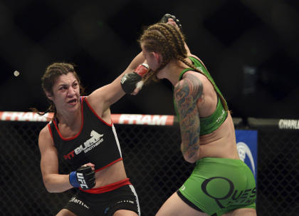 Apr 26, 2014; Baltimore, MD, USA; Bethe Correia (left) punches Ronda Rousey's teammate Jessamyn Duke. (Tommy Gilligan-USA TODAY Sports)