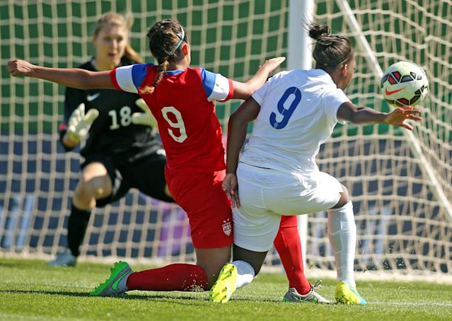 LA MANGA, SPAIN - MARCH 04: Tegan McGrady (L) of USA and Danielle Carter (R) of England fight for the ball during the women's U23 international friendly match between USA U20 and England U23 on March 4, 2016 in La Manga, Spain. (Photo by Johannes Simon/Bongarts/Getty Images)