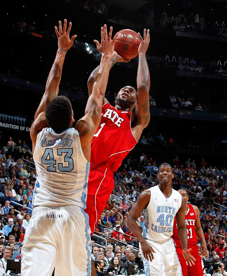 ATLANTA, GA - MARCH 10:  Richard Howell #1 of the North Carolina State Wolfpack shoots against James Michael McAdoo #43 of the North Carolina Tar Heels during the semifinals of the 2012 ACC Men's Basketball Conference Tournament at Philips Arena on March 10, 2012 in Atlanta, Georgia.  (Photo by Kevin C. Cox/Getty Images)
