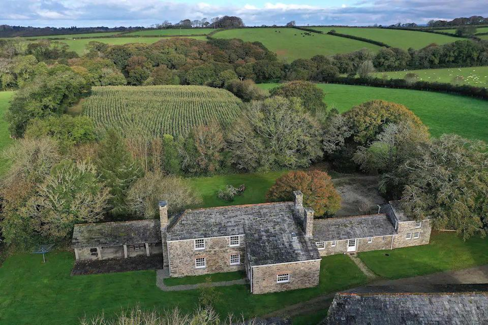 "<p>Looking for a large pad to host a big group? Whether it's family or friends, this remote Airbnb in Cornwall is a dream. The detached holiday cottage is as beautiful inside as it is from the outside: the attractive farmhouse-style kitchen, cosy living room and sumptuous bedrooms. </p><p>There are plenty of luxuries too - the Aga, the <a href=""https://www.goodhousekeeping.com/uk/lifestyle/travel/a28536799/holiday-cottages-cotswolds-hot-tub/"" rel=""nofollow noopener"" target=""_blank"" data-ylk=""slk:hot tub"" class=""link rapid-noclick-resp"">hot tub</a>, the games room to name but a few. This is the country Airbnb of dreams! With the rural setting and location close to Cornwall's beaches and towns, this country cottage is one to add to your wish list.</p><p><strong>Sleeps</strong>: 12</p><p><strong>Price per night:</strong> £935</p><p><strong>Why we love it: </strong>There's everything you need for a family staycation - all the space, the entertainment and plenty of character to impress</p><p><a class=""link rapid-noclick-resp"" href=""https://go.redirectingat.com?id=127X1599956&url=https%3A%2F%2Fwww.airbnb.co.uk%2Frooms%2F34964064&sref=https%3A%2F%2Fwww.countryliving.com%2Fuk%2Ftravel-ideas%2Fstaycation-uk%2Fg32930188%2Fairbnb-cornwall-devon%2F"" rel=""nofollow noopener"" target=""_blank"" data-ylk=""slk:SEE INSIDE"">SEE INSIDE</a><br></p>"