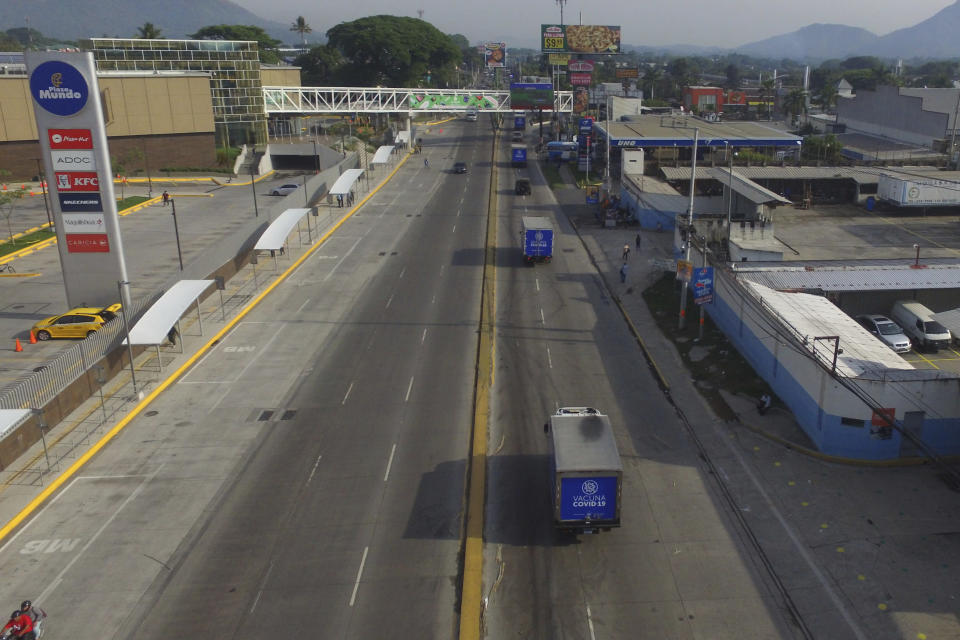 Health Ministry trucks transport doses of COVID-19 vaccines that El Salvador's government is donating and delivering to neighboring Honduras, as they depart San Salvador, El Salvador, Thursday, May 13, 2021. (AP Photo/Salvador Melendez)