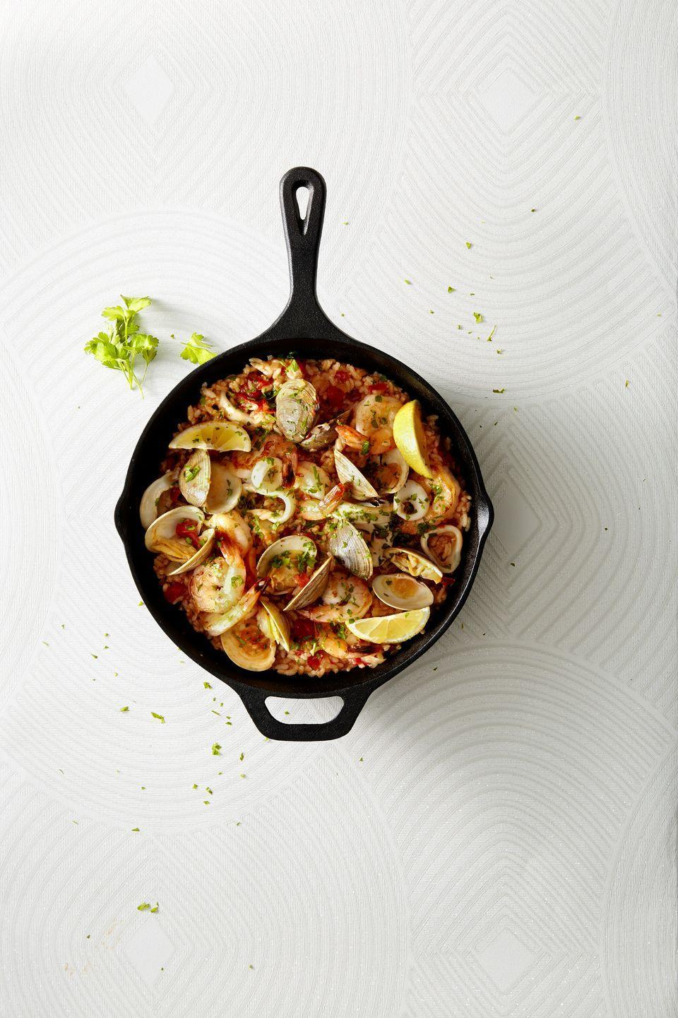 """<p>Throw all your fave seafood into one pot and transport to Spain this summer with just one bite.</p><p><em><a href=""""https://www.goodhousekeeping.com/food-recipes/a42820/easiest-ever-paella-recipe/"""" rel=""""nofollow noopener"""" target=""""_blank"""" data-ylk=""""slk:Get the recipe for Easiest-Ever Paella »"""" class=""""link rapid-noclick-resp"""">Get the recipe for Easiest-Ever Paella »</a></em><br></p>"""