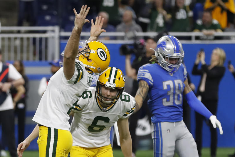 Green Bay Packers kicker Mason Crosby raises his arms after making the winning field goal during the second half of an NFL football game against the Detroit Lions, Sunday, Dec. 29, 2019, in Detroit. Lions defensive back Mike Ford (38) looks on. (AP Photo/Carlos Osorio)