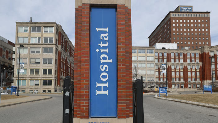 Henry Ford Hospital in Detroit, pictured on March 16. U.S. hospitals are setting up triage tents, calling doctors out of retirement, guarding their supplies of face masks and making plans to cancel elective surgery as they brace for an onslaught of COVID-19 patients. (Paul Sancya/AP)