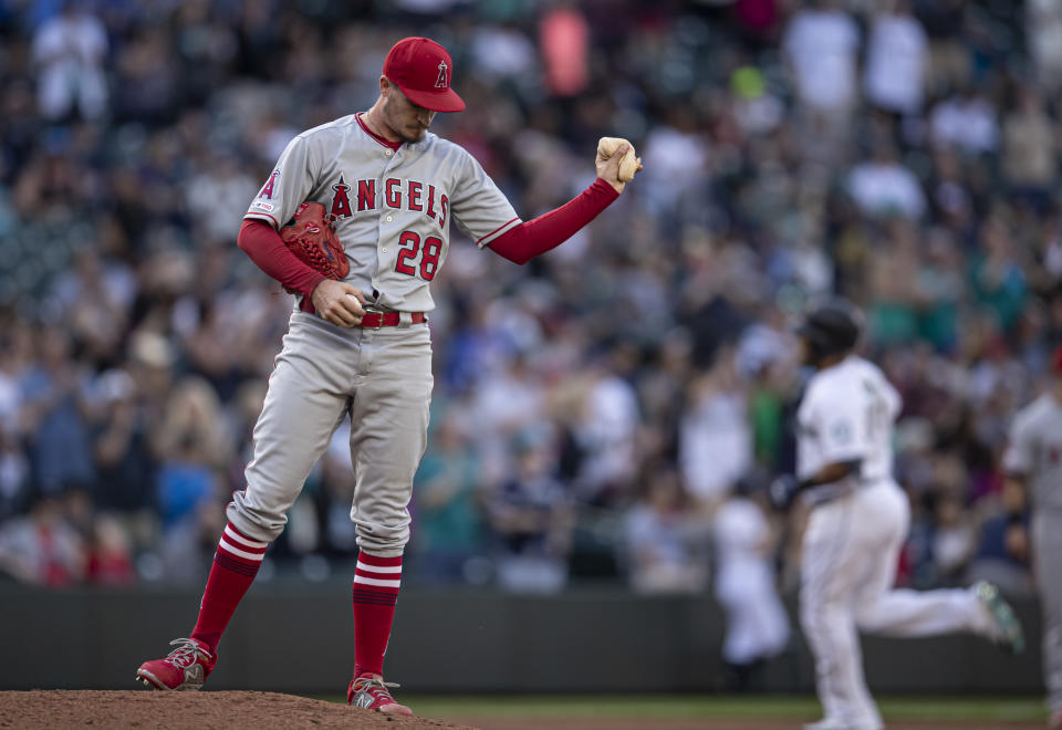 SEATTLE, WA - JUNE 1:  Starting pitcher Andrew Heaney #28 of the Los Angeles Angels of Anaheim throws down the rosin bag after giving up a two-run home run to Edwin Encarnacion #10 of the Seattle Mariners that also scored Mitch Haniger #17 during the sixth inning of a game at T-Mobile Park on June 1, 2019 in Seattle, Washington. (Photo by Stephen Brashear/Getty Images)