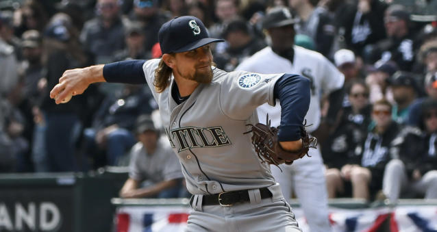 Seattle Mariners' starting pitcher Mike Leake (8) delivers against the Chicago White Sox during the first inning of a baseball game in Chicago on Saturday, April 6, 2019. (AP Photo/Matt Marton)