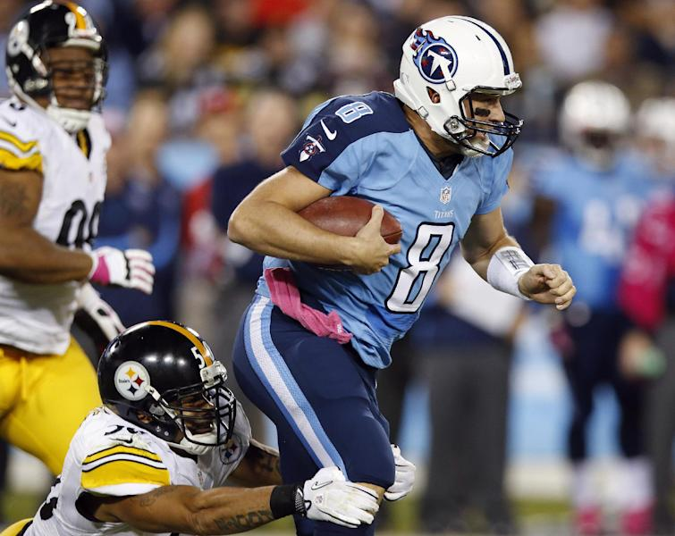 Tennessee Titans quarterback Matt Hasselbeck (8) is tackled by Pittsburgh Steelers inside linebacker Larry Foote (50) during the first half of an NFL football game Thursday, Oct. 11, 2012, in Nashville, Tenn. (AP Photo/Joe Howell)