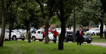 Officials leave after attending a meeting with Paraguay's President Horacio Cartes (not pictured) in the presidential residence in Asuncion, Paraguay April 3, 2017. REUTERS/Jorge Adorno