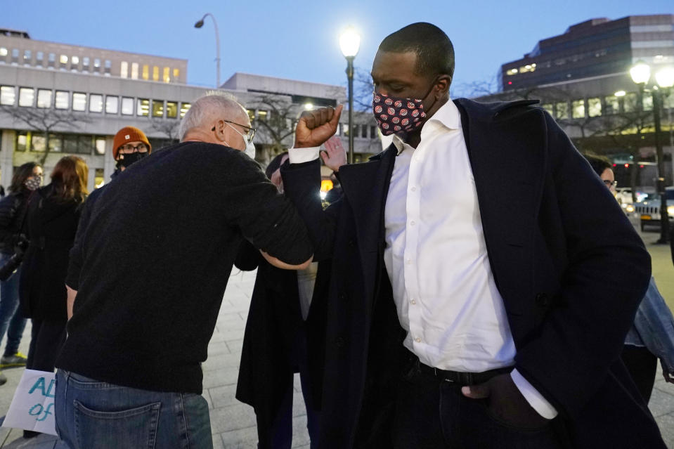 Rep.-elect Mondaire Jones, right, bumps elbows with a supporter after addressing a Protect the Results rally, Wednesday, Nov. 4, 2020, in front of the Westchester County Courthouse in White Plains, N.Y. Jones and Ritchie Torres, both Democrats, became the first gay Black men to be elected to Congress. (AP Photo/Kathy Willens)