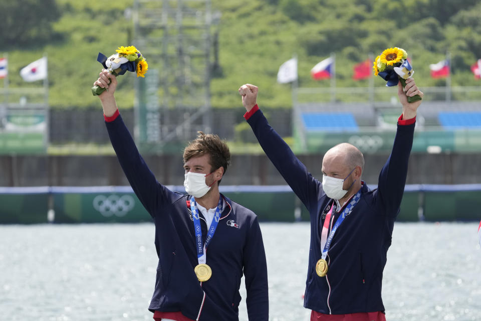 Gold medalists Hugo Boucheron and Matthieu Androdias of France celebrate during the medal ceremony for the men's rowing double sculls final at the 2020 Summer Olympics, Wednesday, July 28, 2021, in Tokyo, Japan. (AP Photo/Lee Jin-man)
