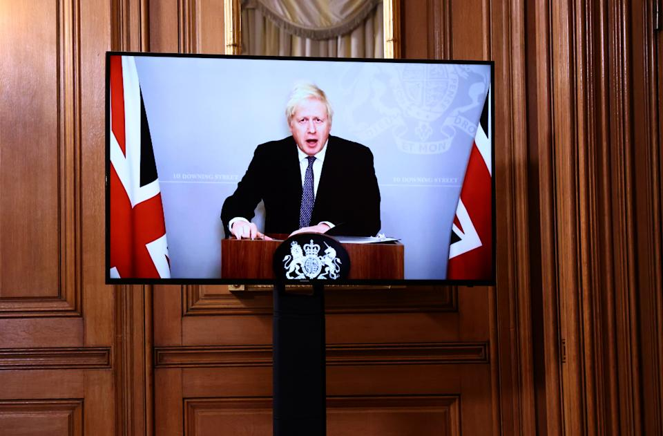 Self-isolating Boris Johnson appears via video-link at the Downing Street press conference on Monday. (Henry Nicholls/PA)