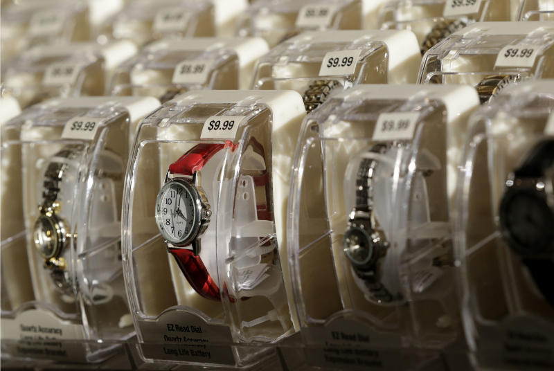FILE - In this Thursday, Nov. 28, 2013, file photo, watches are on display at Kmart in New York. The government reports on consumer prices for November on Tuesday, Dec. 17, 2013. (AP Photo/Julio Cortez, File)