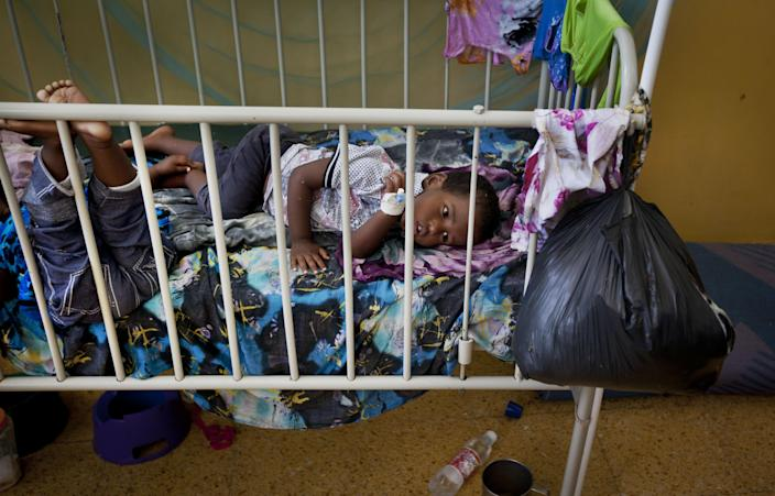 Two Somali children with measles lie in a bed in an isolation ward of the Benadir hospital in Mogadishu, Somalia, Wednesday April 24, 2013. On the eve of the Global Vaccine Summit in Abu Dhabi and coinciding with World Immunization Week, the authorities in Somalia, which has one of the lowest immunization rates in the world, have launched a new push to vaccinate against several potentially fatal childhood diseases. (AP Photo/Ben Curtis)
