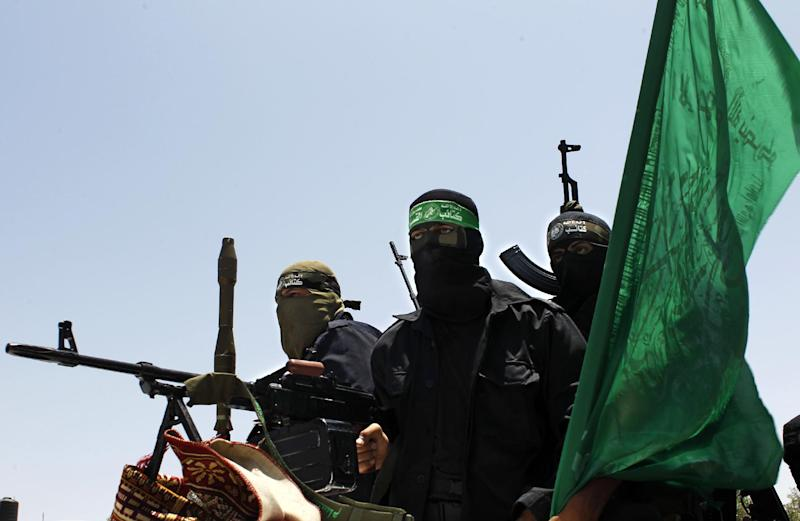 Palestinian militants of the Ezzedine al-Qassam Brigades, Hamas' armed wing, attend the funeral of militant Mohammed Obied in Deir al-Balah, in the central Gaza Strip on June 30, 2014