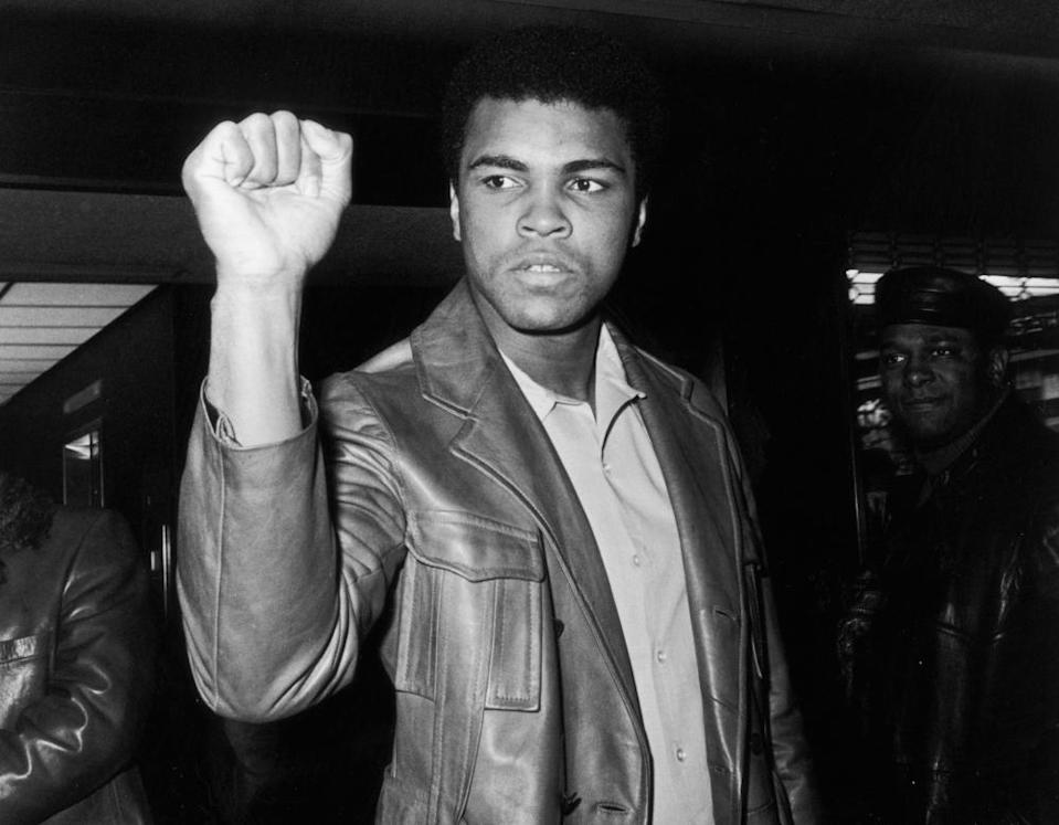 Muhammad Ali gives a Black Power salute in 1971
