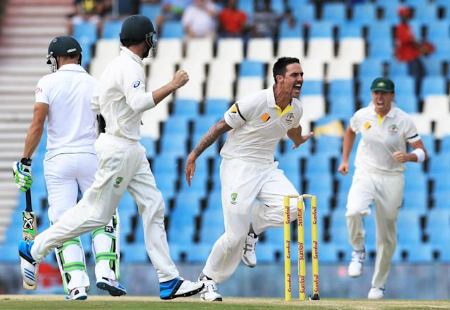 Australia's bowler Mitchell Johnson, second from right, with teammates reacts after dismissing South Africa's batsman Faf du Plessis, left, for 3 runs on the second day of their their cricket Test match at Centurion Park in Pretoria, South Africa, Thursday, Feb. 13, 2014. (AP Photo/ Themba Hadebe)