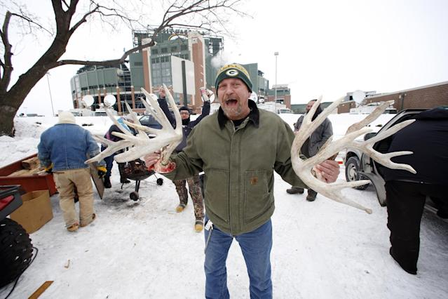 A Green Bay Packers fan shows off antlers as they tailgate before an NFL wild-card playoff football game between the Green Bay Packers and the San Francisco 49ers, Sunday, Jan. 5, 2014, in Green Bay, Wis. (AP Photo/Jeffrey Phelps)