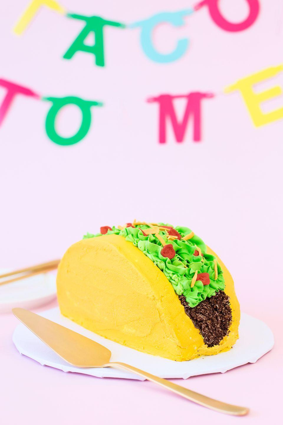 "<p>Whether it's Taco Tuesday or any other day of the week, having a fun fiesta with a taco bar is sure to be a crowd-pleaser. And just wait until you see their faces when this taco cake rolls out!</p><p><strong>Get the re</strong><strong>cipe from <a href=""https://studiodiy.com/diy-taco-cake/"" rel=""nofollow noopener"" target=""_blank"" data-ylk=""slk:Studio DIY!"" class=""link rapid-noclick-resp"">Studio DIY!</a></strong></p><p><a class=""link rapid-noclick-resp"" href=""https://go.redirectingat.com?id=74968X1596630&url=https%3A%2F%2Fwww.walmart.com%2Fip%2FTaco-Bar-Gold-Glitter-Banner-Sign-Garland-Pre-Strung-for-Cinco-De-Mayo-Mexican-Fiesta-Themed-Party-Taco-Bar-Decor%2F249952900&sref=https%3A%2F%2Fwww.thepioneerwoman.com%2Fhome-lifestyle%2Fentertaining%2Fg34192298%2F50th-birthday-party-ideas%2F"" rel=""nofollow noopener"" target=""_blank"" data-ylk=""slk:SHOP TACO BAR BANNER"">SHOP TACO BAR BANNER</a></p>"