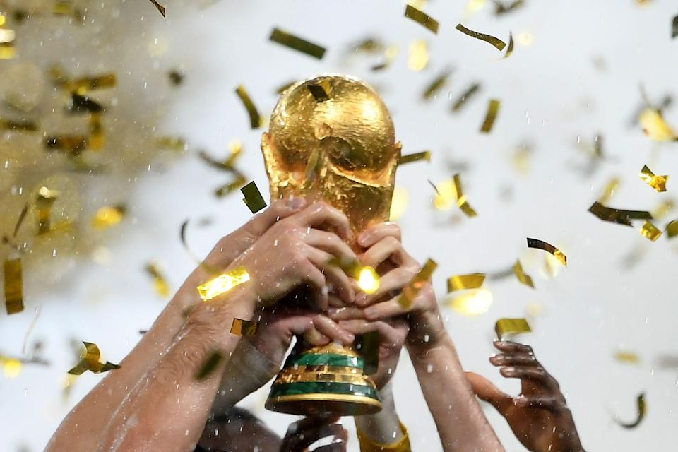 France players hoist the World Cup trophy in 2018.