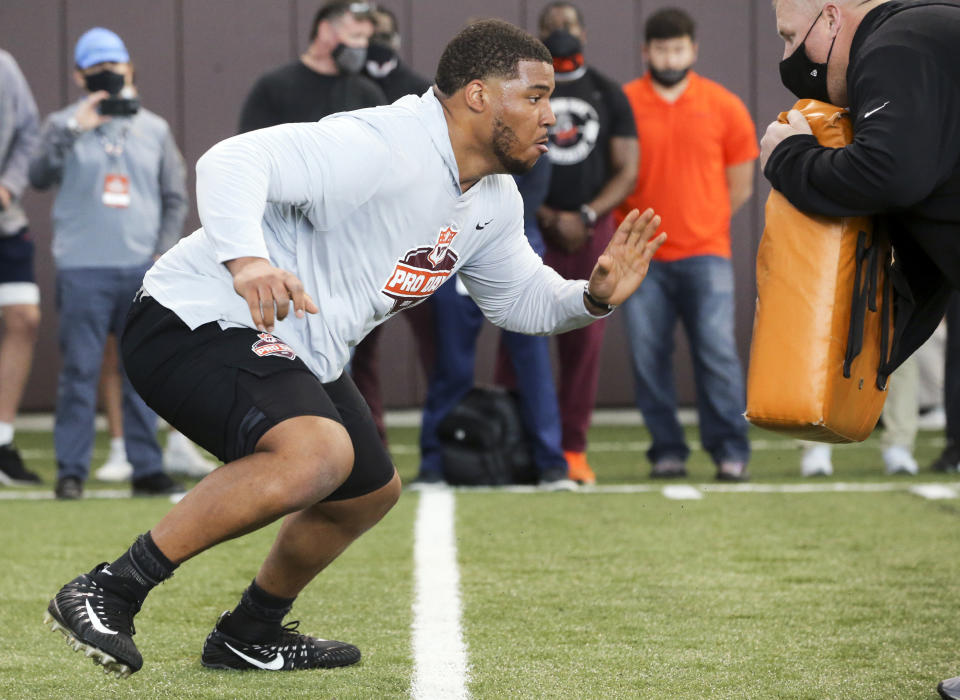 Christian Darrisaw runs a drill Virginia Tech pro day, attended by NFL scouts. (AP Photo/Matt Gentry)