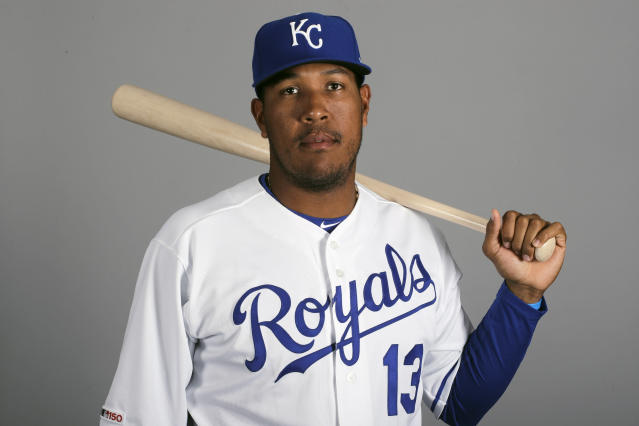 FILE - This is a 2019 file photo showing Salvador Perez of the Kansas City Royals baseball team. Royals star catcher Salvador Perez is about to become a U.S. citizen. Perez passed his citizenship exam earlier this month and will be be joined by Chief U.S. District Judge Beth Phillips on the Royals FanFest main stage Friday, Jan. 24, 2020, to take the oath of allegiance, the Royals said in a news release. Perez signed with the Royals as a 16-year-old prospect from Venezuela. (AP Photo/Charlie Riedel, File)