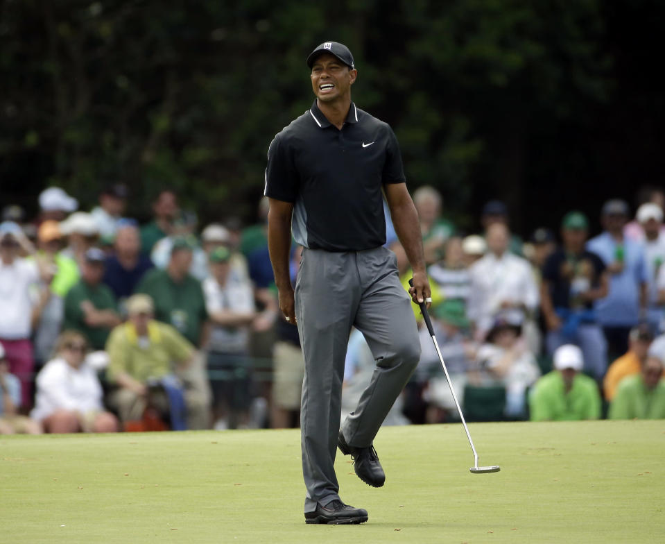 Tiger Woods reacts to his missed putt on the 15th hole during the second round of the Masters golf tournament Friday, April 10, 2015, in Augusta, Ga. (AP Photo/Matt Slocum)