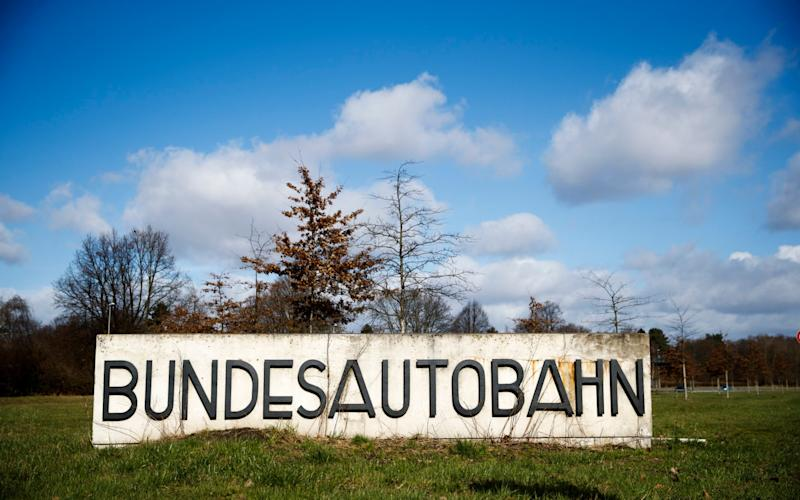 A sign for the Bundesautobahn or Federal Motorway sits on display in Hamburg, Germany, - Credit: Carsten Koal/EPA