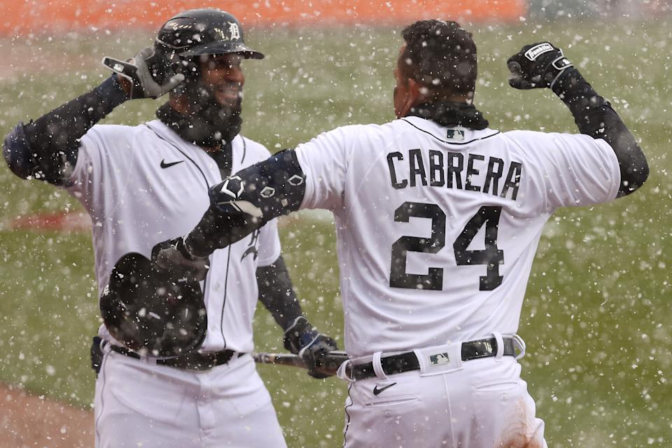 DETROIT, MICHIGAN - APRIL 01: Miguel Cabrera #24 of the Detroit Tigers celebrates his first inning two run home run with Nomar Mazara #15 of the Detroit Tigers while playing the Cleveland Indians during Opening Day at Comerica Park on April 01, 2021 in Detroit, Michigan. (Photo by Gregory Shamus/Getty Images)
