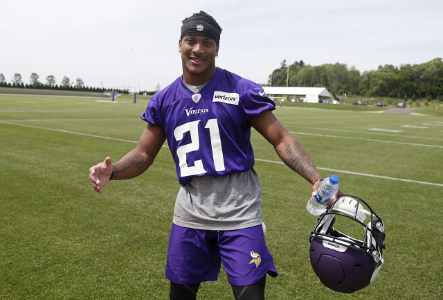 Minnesota Vikings first round draft pick, cornerback Mike Hughes, enjoys the moment before posing for a photo after practice at the NFL football team's training camp in Eagan, Minn., Thursday, June 14, 2018. (AP Photo/Jim Mone)